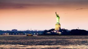 Timelapse with the Statue of Liberty in transition from sunset to night stock video