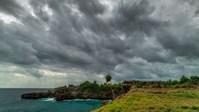 Timelapse Storm clouds over the Nusa Ceningan island in cloudy weather, Bali, Indonesia. 4K Timelapse in Nusa Lembongan and Nusa Ceningan Island, Bali, Indonesia stock video