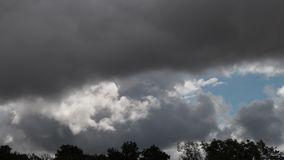 Timelapse of Stormy clouds moving in sky. France stock video footage