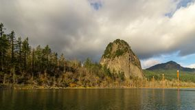 Timelapse of stormy clouds over Beacon Rock along Columbia River Gorge UHD. Ultra high definition time lapse movie of stormy moving clouds and blue sky over stock video footage