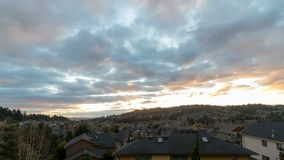 Timelapse of stormy clouds over residential homes in Happy Valley Or sunset 4k. Timelapse movie of stormy clouds and sky over residential homes in Happy Valley stock video footage