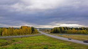 Timelapse of the suburban highway traffic in autumn stock video footage