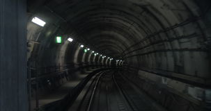 Timelapse of subway train on the route. Timelapse shot of a subway train moving in the dark tunnel and making stops at the stations, view from the cabin. Paris stock video footage