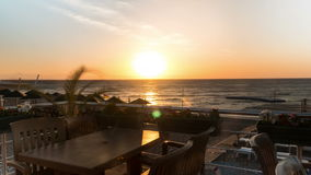 Timelapse sun rises to the sea. The plants fluctuate in the wind stock footage