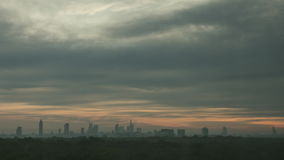Timelapse of sun rising in overcast sky over the city. Timelapse shot of a dawn in Frankfurt and sun hiding in overcast sky. Clouds sailing over the city stock video footage