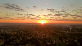 Sunrise from drone. Timelapse sunrise over the city from bird's eye view. Stabilized drone shot, FullHD 1080p stock video