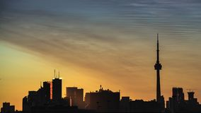 Sunrise in the city. Timelapse of sunrise over downtown Toronto skyline stock footage