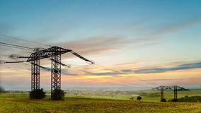 Timelapse sunrise over field with wires stock video footage