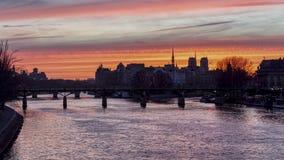 Timelapse: Sunrise over ile de la Cite in winter - Paris. Sunrise over ile de la Cite in winter with Pont des Arts in foreground - Paris, France. HDR Timelapse stock video footage