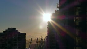 Timelapse sunrise Vancouver. Sunshine beams moving highrise contour stock video footage