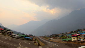 Timelapse sunset at the airport Lukla. Mountains Himalayas, Lukla village, Nepal. Stock Photo