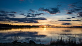 Timelapse sunset at beautiful lake in Sweden. stock footage