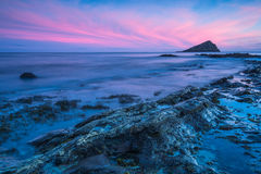 Timelapse sunset and blur water at atlantic beach Royalty Free Stock Images