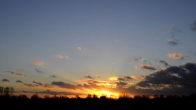Timelapse sunset with clouds stock footage