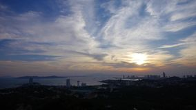 Timelapse sunset clouds,seaside urban skyline & forest. Gh2_06700 stock video footage