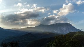 Timelapse sunset and cloudscape over mountain landscape. Moving clouds with dramatic light stock video