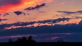 Timelapse. Sunset with flying clouds in Germany