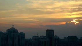 Timelapse of sunset over the city on beautiful the sky and the sun background. 1920x1080 stock footage