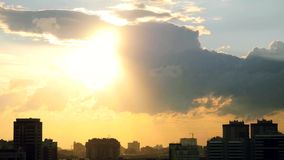 Timelapse of Sunset over downtown city skyline on silhouette of architecture stock footage