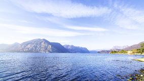 Timelapse of sunset over Lake Iseo, Italy. Panoramic view on the waters of Iseo Lake, Italy. Brescia shore stock footage