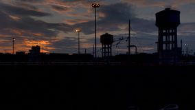 Timelapse of a sunset over a railroad industrial stock video footage