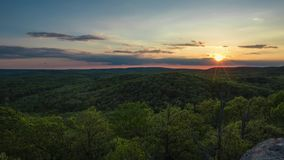Timelapse of sunset over rolling hills of trees in Illinois. Timelapse of sunset over rolling hills and trees in Southern Illinois n stock video