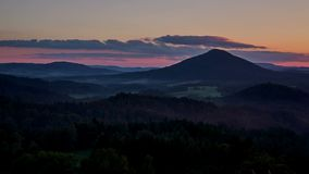 Timelapse of sunset over the Ruzovsky vrch, Bohemian Switzerland stock video footage