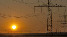 Timelapse Sunset Power Lines and Wind Turbine stock video footage