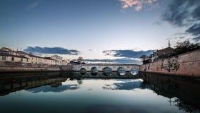 Timelapse sunset on Rimini tiberius bridge. City landscape 4K UHD stock video footage