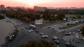 Timelapse.   Sunset on Zorge Street with night traffic at a crossroads in the city of Rostov on Don