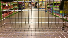 Timelapse of a supermarket trolley during shopping stock video
