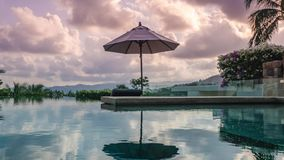 Timelapse of swimming pool at luxury villa at sunset. Horizontal pan. Shot with a Sony a6300 fps 29,97 4k stock footage