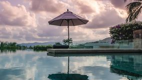 Timelapse of Swimming Pool at Luxury Villa at Sunset. Zoom Out. Shot with a Sony a6300 fps 29,97 4k stock footage