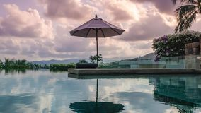 Timelapse of Swimming Pool at Luxury Villa at Sunset. Zoom In. Shot with a Sony a6300 fps 29,97 4k stock video
