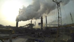 Timelapse of the territory of the metallurgical plant. Of all the pipes are huge clouds of dirty smoke. At the bottom go stock video