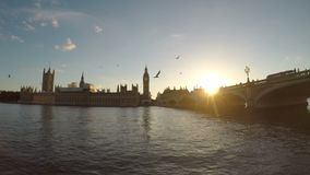 Timelapse of Thames river Big Ben houses of parliament and Westminster bridge at sunset London tourism attraction - stock footage