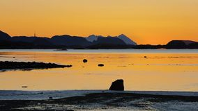Timelapse of tide and sunset over mountain in a fjord stock video