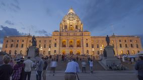 ST Paul, MN - August 2017 - a wide angle twilight shot of people exploring the renovated Minnesota State Capitol stock video