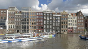Timelapse of touristic water buses on Amsterdam canal stock video