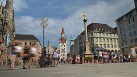 Timelapse of tourists enjoying a sunny summer afternoon in front of the old Town Hall at Marienplatz Square in Munich stock video footage