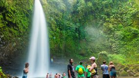 Timelapse Tourists near the Nungnung Waterfall in Bali, Indonesia. July, 2016. 4K Timelapse in Bali Island, indonesia stock video footage