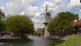 Timelapse. Traditional Holland Windmill on a channel in the Schiedam city near the Rotterdam, Netherlans stock footage
