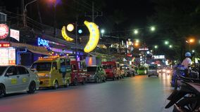 Timelapse: Traditional Tuk-tuk Taxi in the Night Streets of Patong Beach. Public Transport For Tourists near Bangla Road. 18 DEC 2017 - Phuket, Thailand. 4K stock video footage