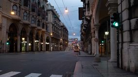 Busses and cars passing by in the center of Genoa stock footage