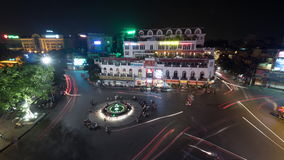 Timelapse of traffic on central square in night Hanoi, Vietnam. HANOI, VIETNAM - OCTOBER 27, 2015: Timelapse shot of traffic on central square of city at night stock footage