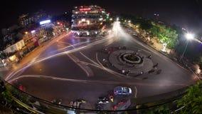 Timelapse of traffic on city square in night Hanoi, Vietnam stock video footage