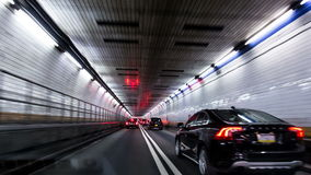 Timelapse with traffic through Holland Tunnel from a driver's PoV. The Holland Tunnel is a highway tunnel under the Hudson River connecting I78 New York City stock video footage