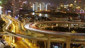 Timelapse,traffic lights trail & vehicles on shanghai overpass bridge at night. Timelapse,driving & cars racing by with streaking lights trail on overpass at stock video