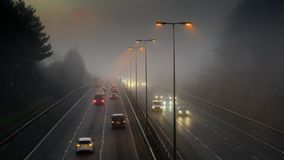 Timelapse Of Traffic On Motorway. From Dark Through Sunrise To day On Foggy Morning stock footage