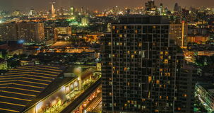 Timelapse of traffic on road with high building at bangkok at nigh. T,Thailand stock footage
